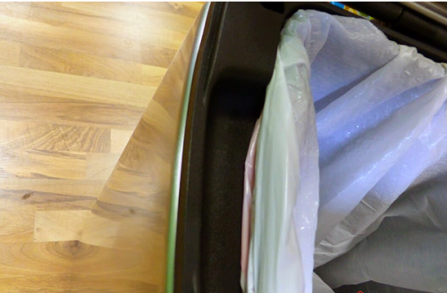 There is very little space between the can body and the liner, especially with a bag attached.